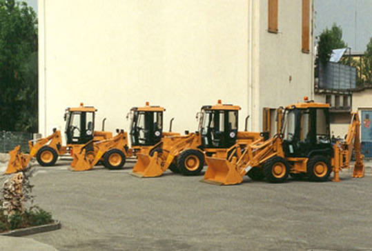 Image circa 1992 of several discontinued rigid type backhoe loaders